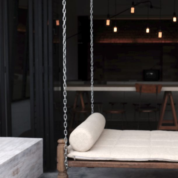 hanging bed with metal chain at balcony,showing indoor designs